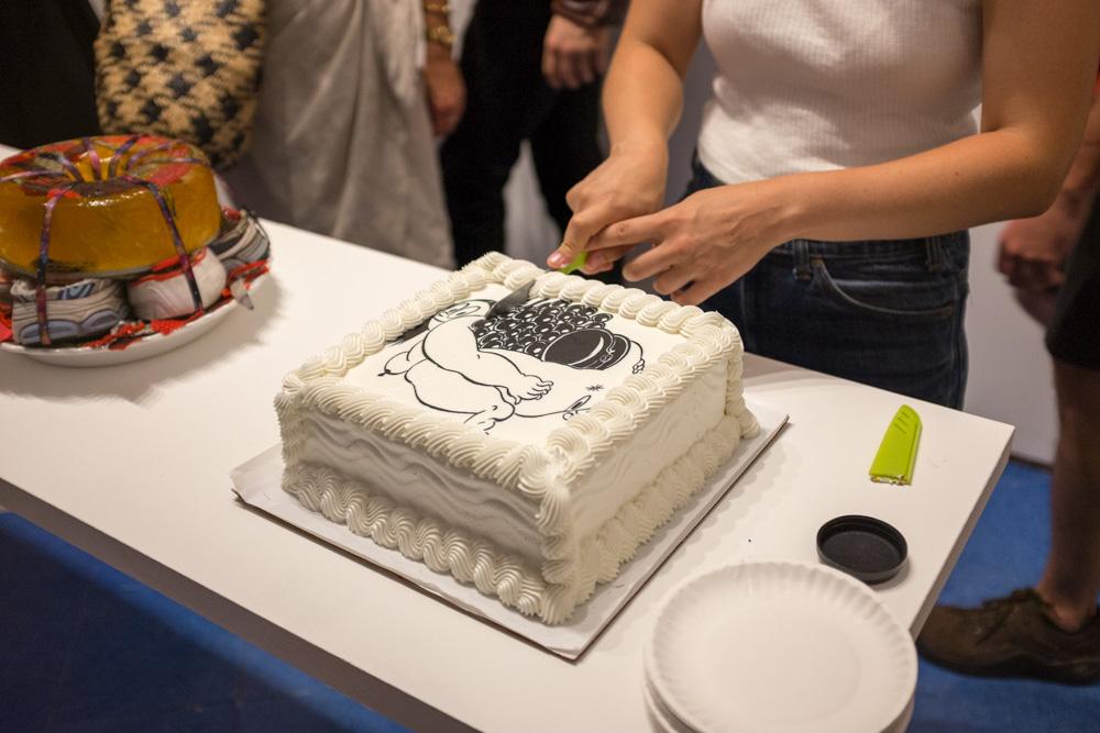 Cutting Ebecho Muslimova's <em>Fat Ebe</em> cake