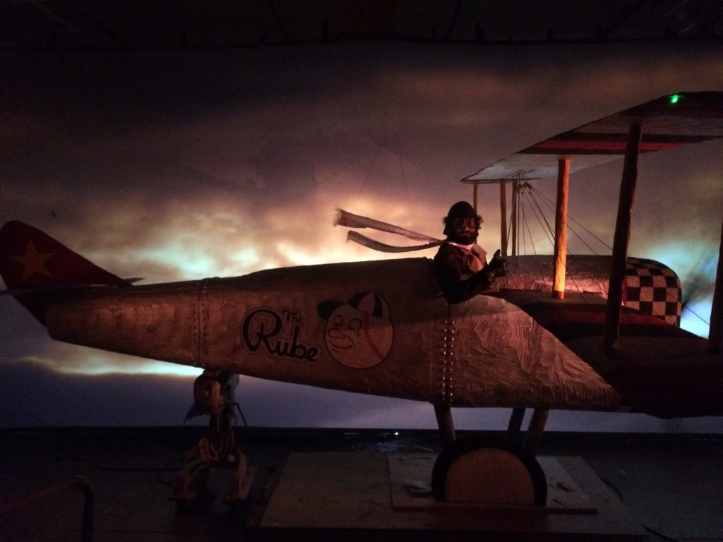 Production still of Jonathan Campolo flying a bi-plane in