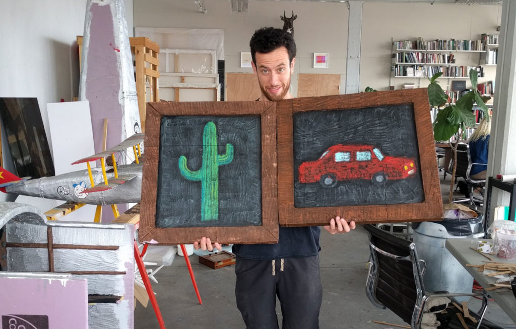Eamon Monaghan with prop paintings in his studio in Sunset Park
